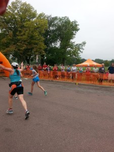 Crossing the Finish Line with my arms up in the air!